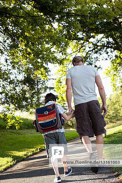 Father Walking Son To School