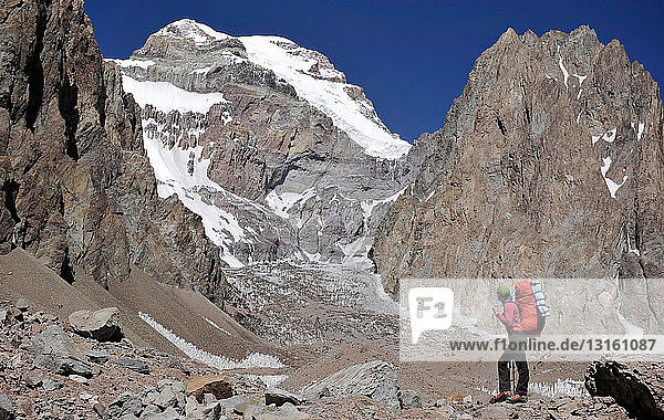 Woman looks at the East Face of Aconcagua in the Andes Mountains  Mendoza Province  Argentina
