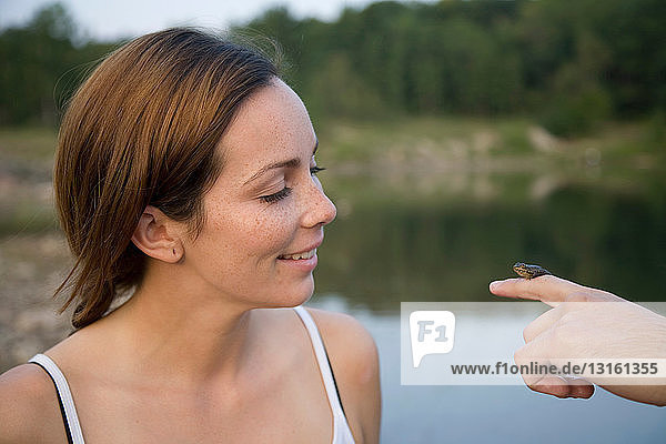 Woman looking at frog
