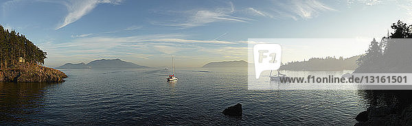 Panoramic view of lake and distant Mount Constitution  Orcas Island  Washington State  USA