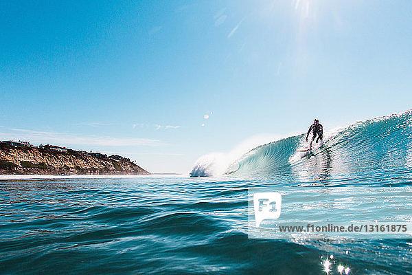 Young man surfing ocean wave  Encinitas  California  USA
