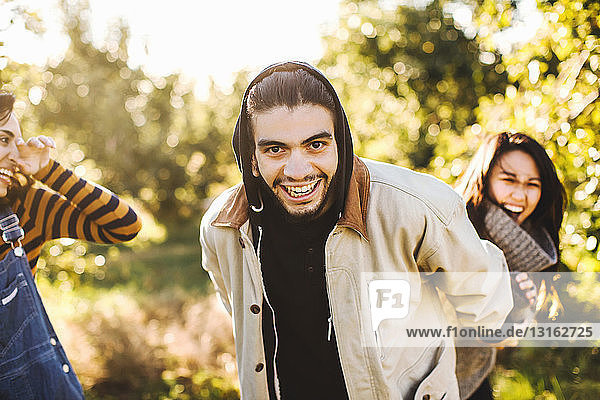 Group of friends  in rural environment  fooling around  laughing