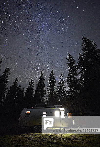 Camping trailer and starry sky at night  Diamond Lake  Oregon  USA