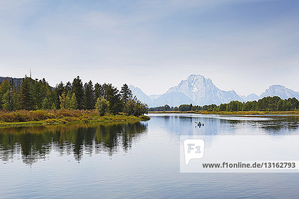 Paddling the calm waters of Oxbow Bend by kayak in Grand Teton National Park  Wyoming  USA