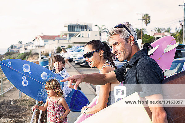 Family at coast with surfboards  Encinitas  California  USA