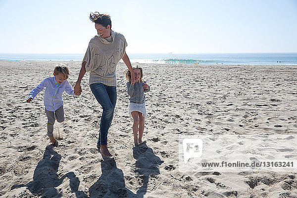Mother holding hands with son and daughter  Newport Beach  California  USA