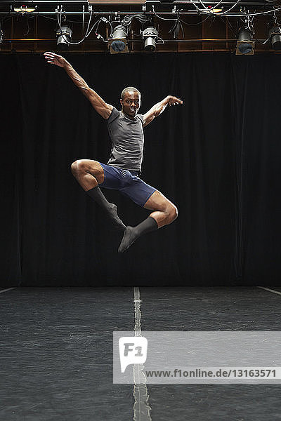 Dancer in midair pose