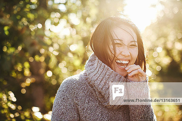 Portrait of young woman in rural environment  laughing