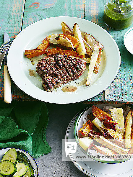 Plate of steak salsa verde with sweet potato chips