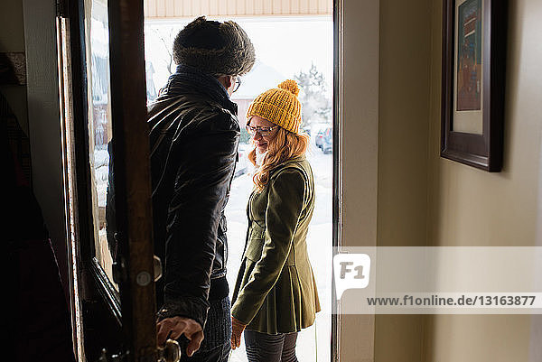 Couple leaving house in winter