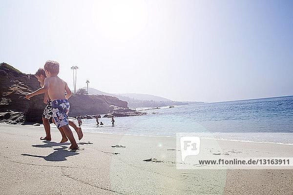 Brothers playing on beach  Laguna Beach  California  US