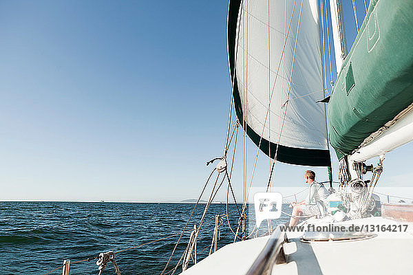 Young man on deck of yacht