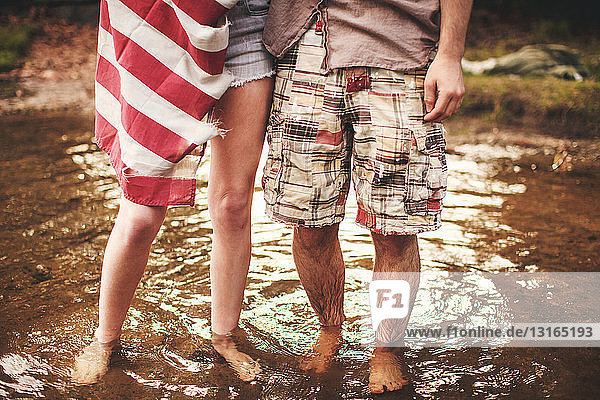 Young couple standing in shallow water