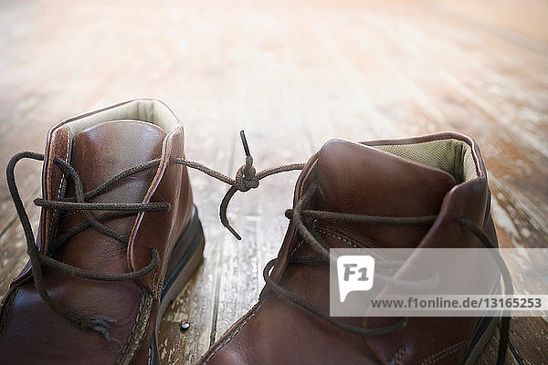 Boot laces tied together