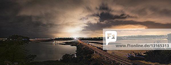 Panoramic view of estuary and railway bridge at night  Carlsbad  California  USA