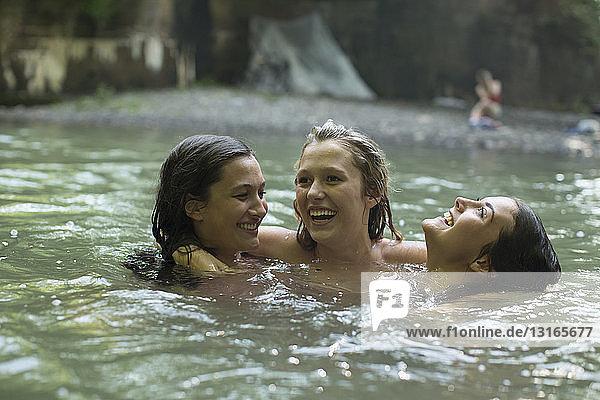 Teenage girls having fun in the river