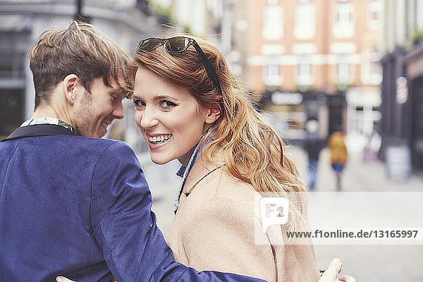 Portrait of couple strolling along street  London  UK
