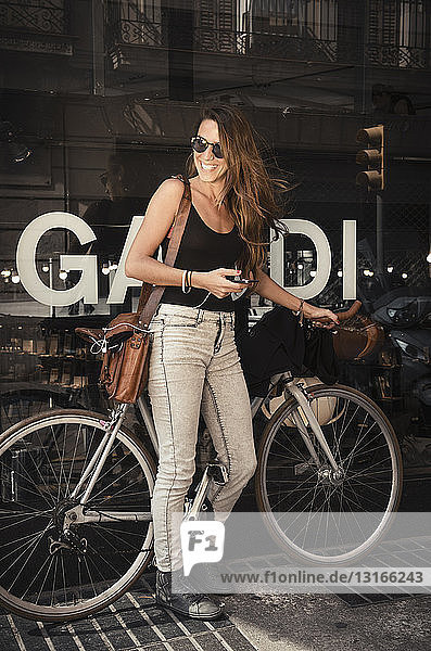 Woman standing outside shop  Barrio Gotico  Barcelona  Spain