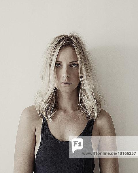 Portrait of young woman wearing black vest