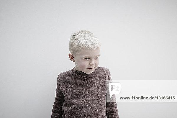 Portrait of boy wearing brown jumper  looking away