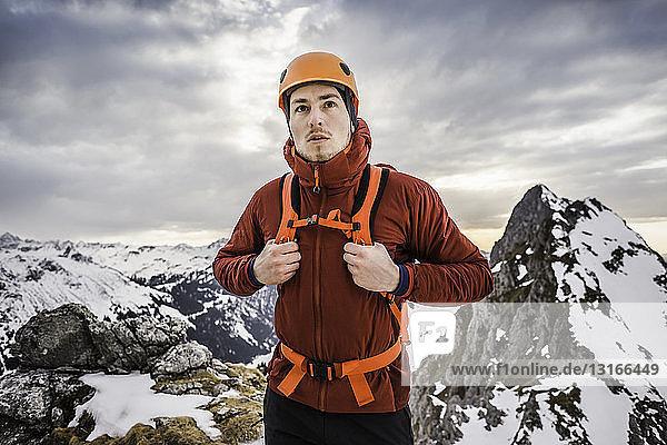 Hiker wearing helmet on mountain  Kellenspitze  Tannheim mountains  Tyrol  Austria