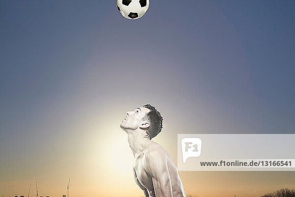 Man in park with football