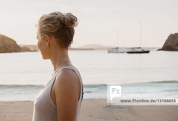 Mid adult woman looking out from beach  Menorca  Balearic islands  Spain