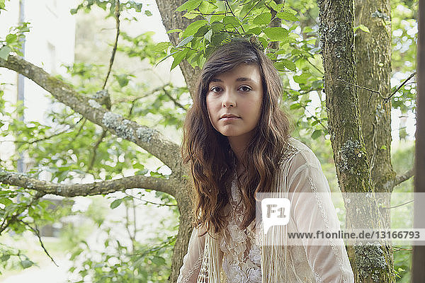Portrait of young woman in woods