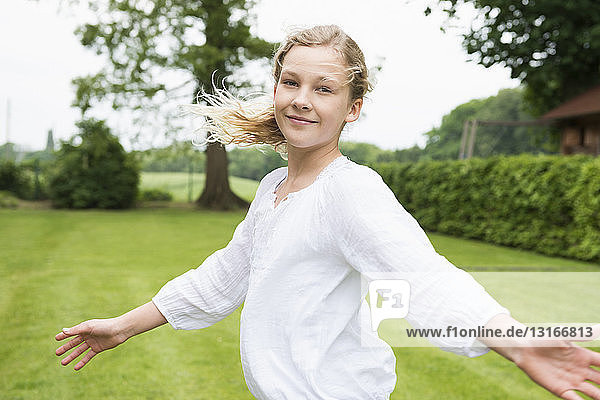 Girl wearing white top with arms out