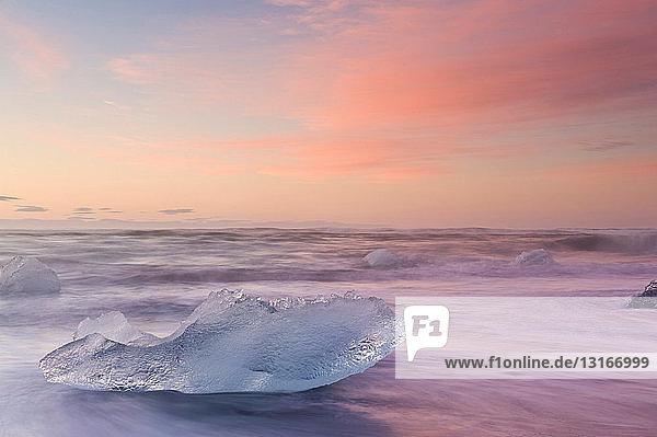 Iceberg on beach at dusk  Jokulsarlon  Iceland