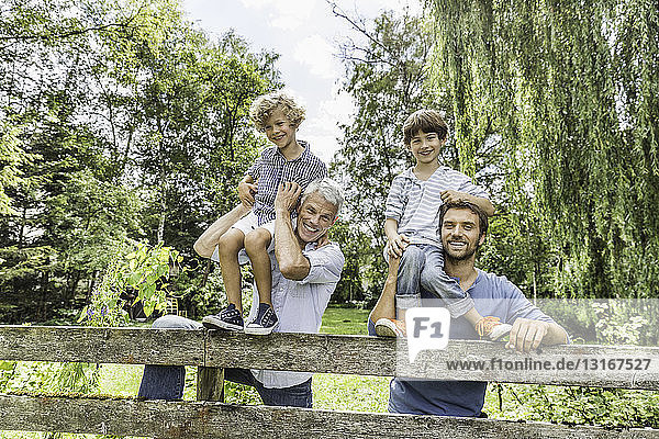 Portrait of three generation family males in garden