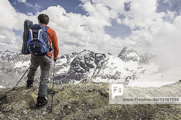 Young man looking at view in Bavarian Alps  Oberstdorf  Bavaria  Germany