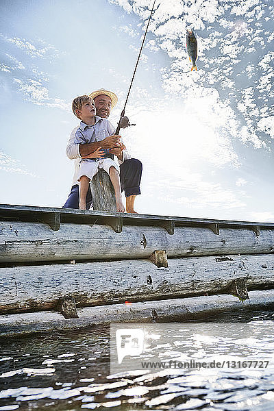 Father and son fishing  Utvalnas  Sweden