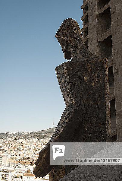 Detail of statue and La Sagrada Familia  Barcelona  Spain