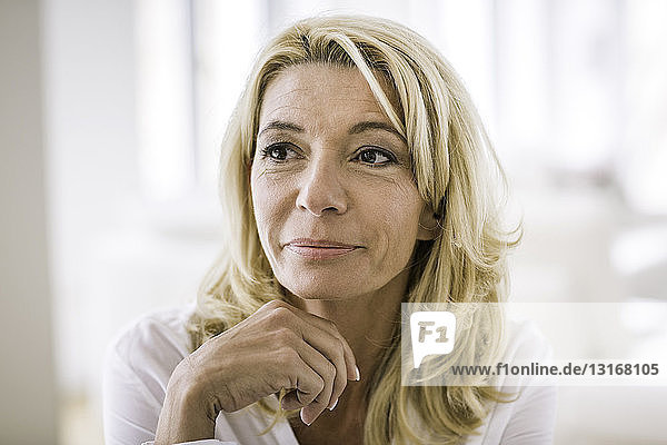 Portrait of blonde haired woman looking away