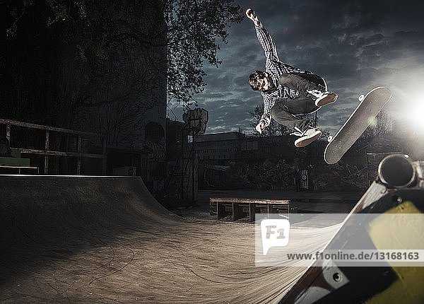 Skateboarding on mini ramp  Bigspin flip  Berlin  Germany