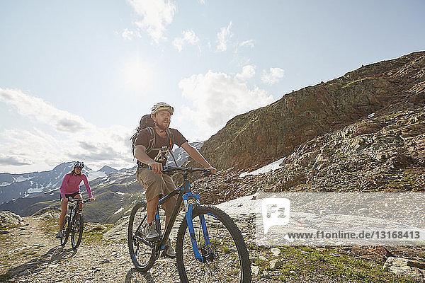Young couple mountainbiking at Val Senales Glacier  Val Senales  South Tyrol  Italy