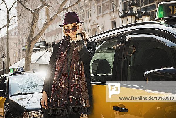 Woman standing beside cab  La Rambla  Barcelona  Spain