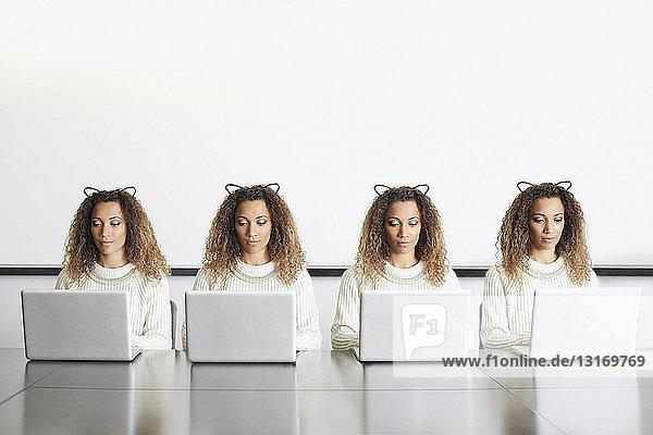 Businesswomen wearing ears using laptops