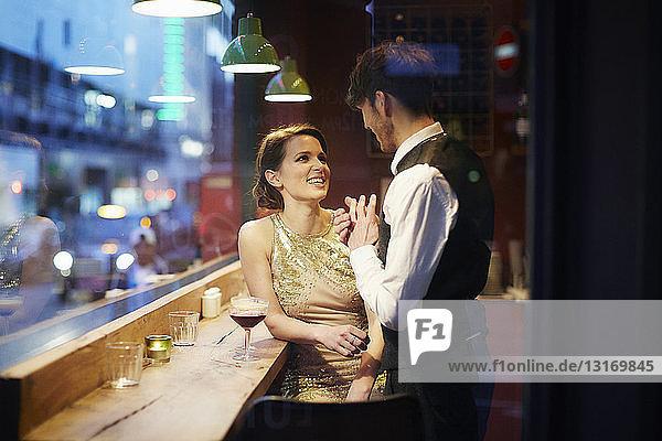 Couple talking in bar