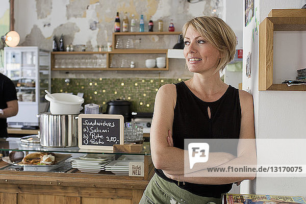 Mid adult woman in cafe