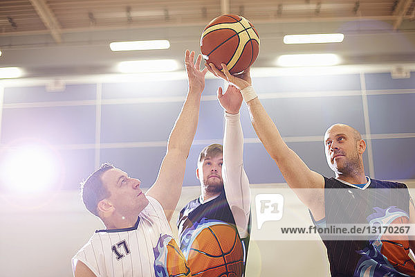 Wheelchair basketball players playing basketball