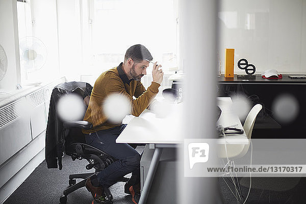 Casual businessman working at desk
