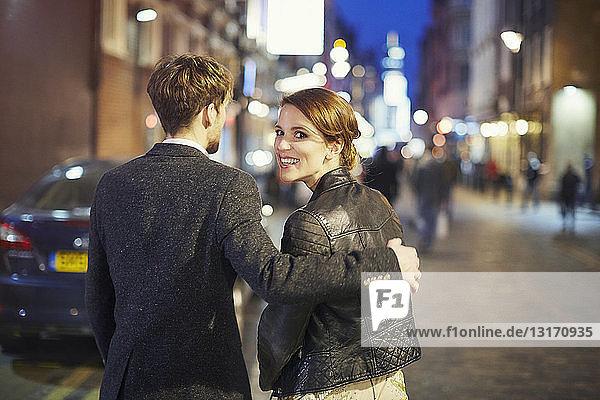 Couple on street at night  London  England