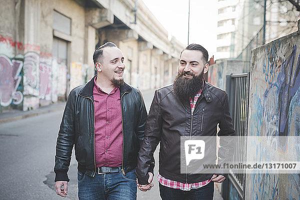 Gay couple walking on street