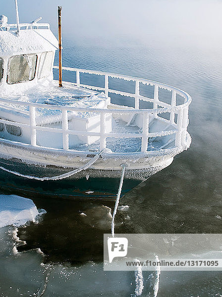 A boat moored in the extreme cold at a lake in Jarfjord  near Kirkeness  Finnmark region  northern Norway