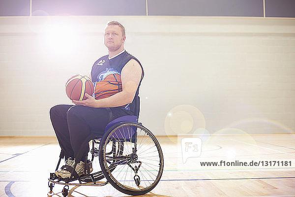 Wheelchair basketball player holding ball