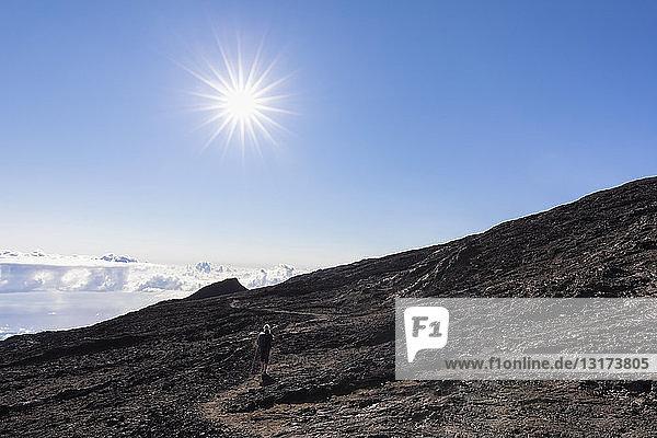 Reunion  Reunion National Park  Shield volcano Piton de la Fournaise  female tourist hiking to crater