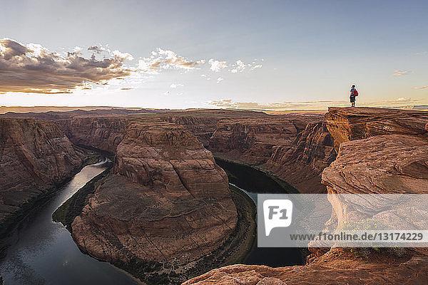 USA  Arizona  Colorado River  Horseshoe Bend  young man standing on viewpoint