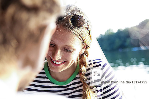 Smiling young woman with man at a lake